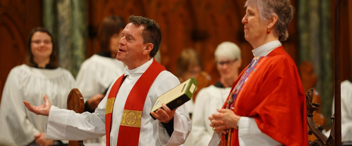 Robert pronouncing the blessing following his ordination at St. Andrew's, Oregon Hill. Photo credit: Jay Paul