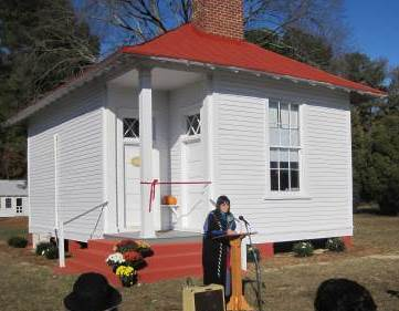 Nellie Adkins, co-chair of Native American Ministries for the Diocese, celebrates the opening of the Pamunkey School House